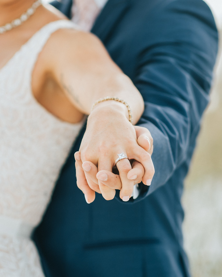 Hands Holding Wedding Ring Photography | Bown Media